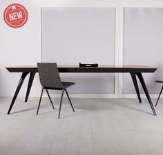 Milton Dining Table for Sale - features painted metal frame with wood top. Seats 10 guests. Available in black painted steel legs with teak wood table top.