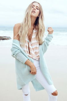The beautiful Mint Cardi is designed as a longline cut, finely woven. Open style cardigan with two front pockets. Vertically ribbed design, relaxed fit. Style Tip: Perfect styled over skinny jeans with a basic tee. By Sabo Skirt