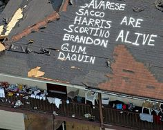 A Sign of Hope: The names of survivors are painted on a roof