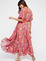 Lovebird Half Moon Gown   Easy breezy maxi dress featuring a bold exotic print and a deep V-neckline. Effortless drawstring ties at the waist. Femme, flowy silhouette.