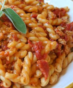 Marcella Hazan's chicken thigh pasta sauce with tomatoes and herbs. One of our very favorites.