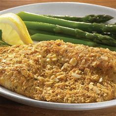 Parmesan Herb Encrusted Tilapia: Finely chopped almonds, bread crumbs and Parmesan cheese combine to make a crust for tilapia that's tasty enough for a restaurant menu.