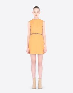 """Short crew neck dress in crepe couture with V Rockstud belt. <br>- Rear zip and hook-and-eye fastening. <br>- Leather belt with metal V-Rockstud. <br>- Topstitching detail to the chest. <br>- Length 35"""". <br>- Silk lining. <br>- Crepe Couture (65% Virgin Wool, 35% Silk). <br>- Regular fit. <br>- The model is 5'9"""" tall and wears an Italian size 40. <br>- Made in Italy.   Women 34566823GQ"""