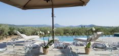 Loana is located in an idylic setting in the best area of Island. The View from thhe villa is spectacular with views of the sea and its olive plantation. Villas, Costa, Luxury Villa, The Good Place, Greece, Around The Worlds, Patio, Places, Outdoor Decor
