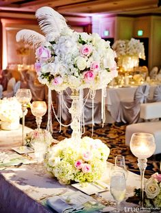 feather+centerpieces | glamorous vintage wedding centerpiece with pearls and feathers