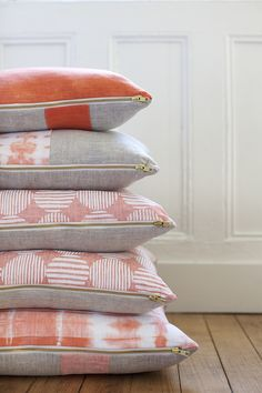 Introducing The Williamson Collection - orange patterned pillows stacked