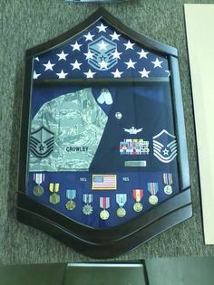 I hope that the pictured shadow box is found and returned to its rightful owner -- Side note: Definitely something that I would like to have made for my husband one day.