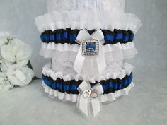 http://www.creativegarters.com/products/because-you-are-mine-i-walk-the-line-garter-police-wedding