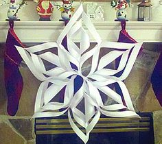 3-D snowflakes!  All you need is 6 pieces of paper...scissors...tape and a stapler! Soooooo easy and fun to make!