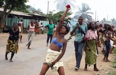 Women protest against growing cost of daily living conditions on March 31, 2008 in Yopougon, neighborhood of Abidjan. Police used tear gas to disperse the several hundred people, mainly women, protesting.