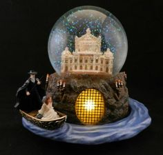 PoTo water globe. I could probably never justify spending so much money on a decorative (albeit amazing) item, but it's fun to look at. :)
