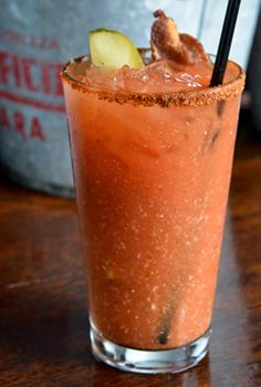 The Elixir Bloody Mary with a bacon and dill-pickle garnish and an Old Bay Seasoning rim. This spicy vodka drink makes an amazingly delicious hangover cure.