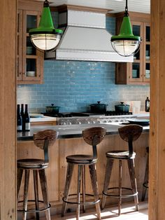 By drawing the eye up with their kicky color and oversize scale, these lamps make the space feel more open and bright.