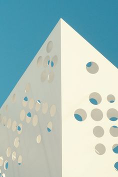 White Hole Punch Architecture Under a Blue Sky
