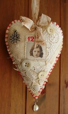 Hearts - a pretty way to use treasured scraps of fabric, buttons and bows.  Hang on a knob on your dresser or china cabinet.  Could be a sachet????
