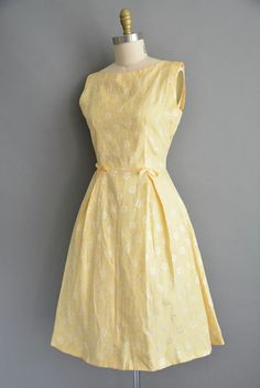Cute vintage 1950s dress in a wonderful charming yellow color, bust darts with a flattering nipped waist fit, two small bow details, full skirt, back zipper for closure. ✂------ M E A S U R E M E N T S ------- best fit: medium / large bust: 36 waist: 29 hips: open fit total length: 41  material: taffeta condition: excellent _______________________________ ☆ visit the shop ☆ http://www.etsy.com/shop/simplicityisbliss _______________________________ ☆ Come say Hello! Find us on:  ➸ instagram…