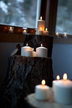 "Wood stumps with candles on them framed our ""alter."" We also had candles all over the window sills of the room. Picture courtesy Julie Patton Photography, LLC"