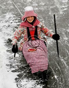 Europe   Portrait of a woman wearing traditional clothes, a traditional hat and sledging, Hindeloopen, Friesland, The Netherlands