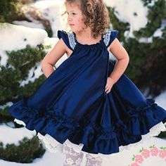 Swing Dress Girl's Sewing Pattern by Handmaiden's Cottage. Credits: Buyer photo Melissa S.