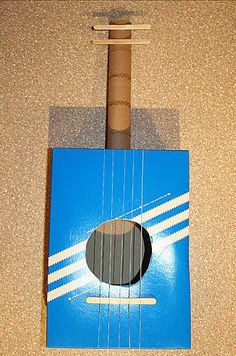Make sweet sounds with this Kleenex® Tissue box guitar craft from the Monkeytail and Wellington Blog!