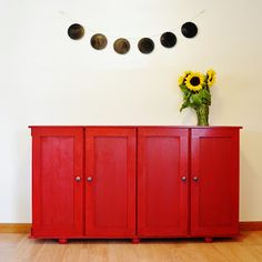 This is just two unfinished cabinets from IKEA. Look how cute! Maybe we could paint them greenish blue.