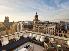 The location of this former bank headquarters, which opened as a hotel at the end of 2009 on the lovely Passeig de Gràcia, ensures that guests can easily stroll to restaurants and shopping. The very contemporary and modern room design by Spaniard Patricia Urquiola mixes leather and velvet upholstery with a palette of green, black, and gold.