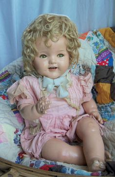 1935 composition Shirley Temple doll with flirty eyes very hard to find.