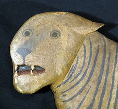Dated 1945 folk art carved tiger. Possibly a circus carving or part of a trade sign.