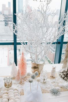 Vases with white manzanilla branches give the look of a Winter forest, just like the Arendelle setting of Frozen. Photo by Ardita Kola via Style Me Pretty