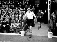Middlesbrough's George Hardwick walks out of the tunnel at the Valley for the game against Charlton in 1949.