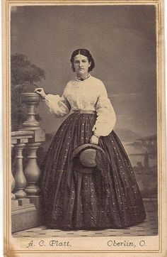 1860's Young lady wearing a nice shirt and blouse holding hat.  Good example of simple, useful day wear; CDV.