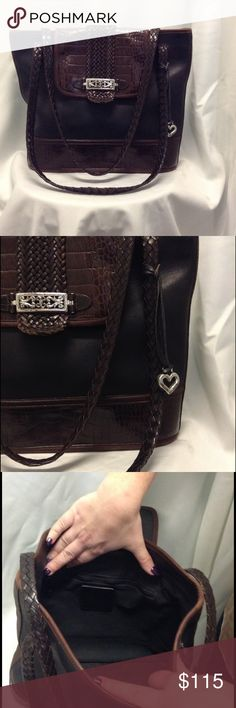 Beautiful Brighton purse Beautiful black leather Brighton purse with woven accents and silver details. Amazing condition. Very spacious inside and larger putter pocket on back side. Brighton Bags Shoulder Bags