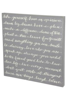 "This inspiring sign features an elegant design with a gray background and lightly distressed edges. The words say: ""Like yourself have an opinion dream big dreams have a plan make a difference dance often plant a tree leave footprints read everything you can smile be daring love who you are speak up change your world be the friend you'd like to have love life live every moment don't quit smile at strangers learn new things laugh believe.""  Measures: 26"" x 26""  Like Yourself Sign by…"