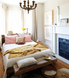 relaxed boho chic bedroom - love the bench and chandelier