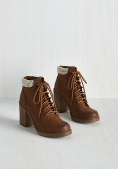 Rave Reviewer Bootie in Cognac. When a new spot opens downtown, lace up these cognac brown booties and see what the hypes about! #brown #modcloth
