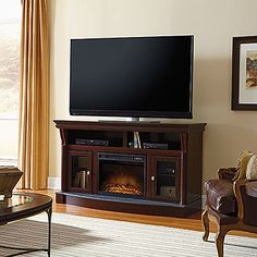 Accommodates up to a 60 in. TV weighing 95 lbs. or less. Adjustable shelf behind each framed, safety-tempered glass door. Divided, open shelving holds audio/video equipment. Electric firebox includes remote control and thermostat settings to heat up to 400 square feet. Faux slate hearth. Select Cherry finish.