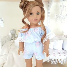 18 inch doll periwinkle floral print romper with lace trim.
