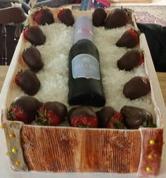 wine bottle an chocolate covered strawberries cake