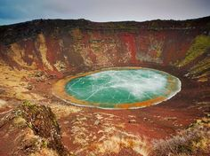 While many crater lakes are deep within black volcanic rock, the rock around the colorful Kerið Lake in Iceland is a mix of red, brown, and pink. The 3,000-year-old crater sits within the tourist route known as the Golden Circle.