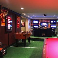 Rec Room turf football floor, oh if my husband had his way he would pick this