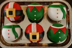 Since there's an elf cupcake I'm pinning this here. LOL. Santa, Elf, and Snowman Belly Cupcakes!