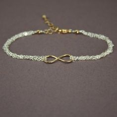 Two Tone Infinity Bracelet - Multistrand 14k Gold Filled and Sterling Silver  Bracelet with Infinity Symbol - Figure 8. $56.00, via Etsy.