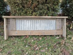 Rustic Reclaimed Barn Wood Shelf with Metal Hooks and Corrugated Metal Detail via Etsy.