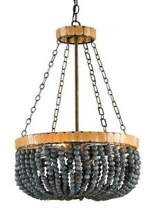 Part of Currey & Co.'s new Marjorie Skouras collection, the four-light Lana chandelier is made of wrought iron and glass. WTC 10008. www.curreyco.com