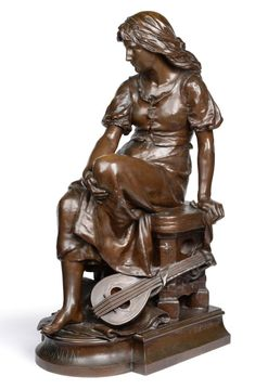 Eugene-Antoine Aizelin (French, 1821-1902): ''Mignon'', A Bronze Figure of a Seated Girl, a lute at her feet, on a bowfront rectangular base titled MIGNON, signed E AIZELIN and inscribed F.BARBEDIENNE Fondeur Paris, stamped Reduction Mecanique, 81cm high See illustration