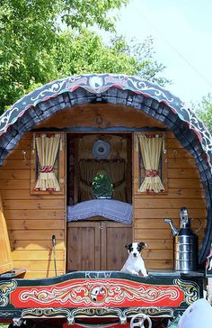 Gypsy caravan and pup ~ if I could cram all my yarn and a spinning wheel or two in there, I'd be all set. Oh yes, and I'd need an alpaca or two to pull it!!