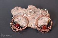 """Bohemian Sunset - OOAK  Inspired by henna, bohemia and tribal designs  Freeform copper wire, embracing 10mm carnelian cabochons and a strand of copper beads. The freeform nature of this technique means that these earrings are one of a kind (OOAK).  Length: 5cm/2""""  ** All my ear posts are made of sterling silver and are nickel free."""