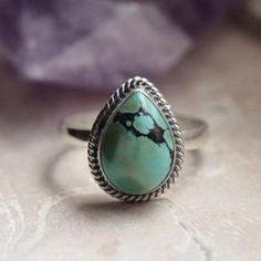 A genuine Turquoise gemstone set in 925 Sterling Silver Ring with Rope pattern surrounding the teardrop gemstone. This style is chill enough to wear daily but has a unique shape and pretty feel. You can choose what you would like stamped or engraved on the back of the stone area into the silver by writing it in the buy Turquoise Gemstone, Peace And Love, Aztec, Sterling Silver Rings, Hand Carved, Chill, Autumn Fashion, Shape, Jewels