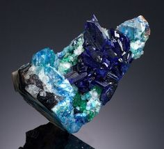 A specimen of a copper mineral called linarite contains unusual large crystals.