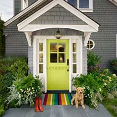 How to Pull off a Bold Front-Door Paint Color lime green front door set into a grey house with white trim. a rainbow rug sits in front of the door with a yellow puppy to one side, and red rubber boots on the other Bright Front Doors, Yellow Front Doors, Front Door Paint Colors, Painted Front Doors, Paint Colors For Home, House Paint Exterior, Exterior House Colors, Blue Siding, Facade Design
